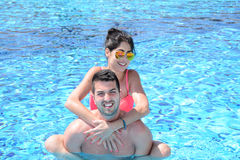 Happy young couple in the pool. Happy young couple on summer vacation Royalty Free Stock Photography