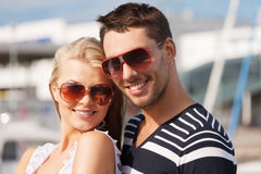 Happy young couple in port Stock Images