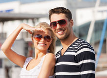 Happy young couple in port Royalty Free Stock Photos