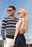 Happy young couple in port Royalty Free Stock Image