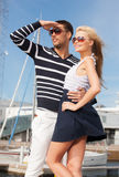 Happy young couple in port Stock Photos