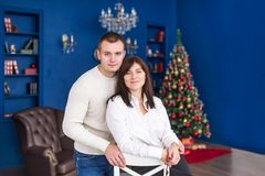 Happy young couple posing at home at Christmas time royalty free stock image