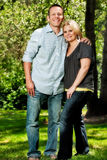 Happy young couple posing in park Stock Images