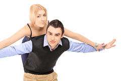 Happy young couple posing piggyback Stock Photography
