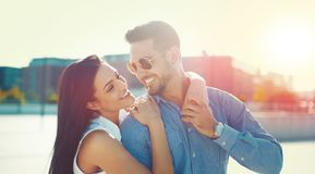 Happy young couple posing in sunset outdoors royalty free stock images