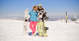 Happy young couple posing with their snowboards Stock Images