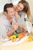 Happy young couple preparing a dinner Stock Photo