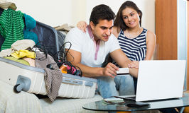 Happy young couple preparing for voyage Stock Photo