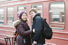 Happy young couple on railway station platform Royalty Free Stock Photography