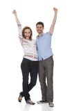 Happy Young Couple Raising Hands Stock Image