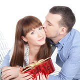 Happy young couple with red gift Royalty Free Stock Photos