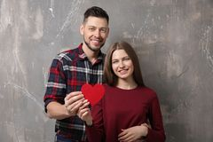 Happy young couple with red heart Stock Photos