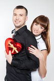 Happy young couple with red hearts Stock Photos