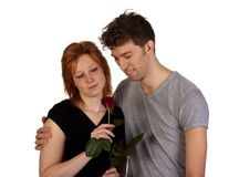 Happy young couple with red rose Stock Image