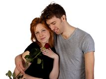 Happy young couple with red rose Royalty Free Stock Photo