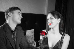 Happy Young Couple with Red Rose Flower Stock Image
