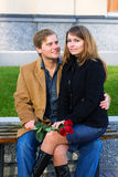 Happy young couple with a red roses. Stock Photos