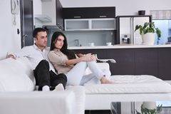 Happy young couple relax at home Royalty Free Stock Photos