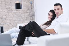 Happy young couple relax at home Stock Images