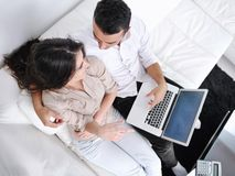 Happy young couple relax at home Stock Image