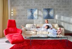 Happy young couple relax at home Royalty Free Stock Images
