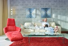 Happy young couple relax at home Stock Photos