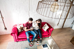 Happy young couple relaxed at home with a bunny pet Stock Image