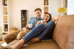 Happy young couple relaxing on the couch Royalty Free Stock Photo