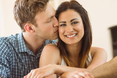 Happy young couple relaxing on the couch Royalty Free Stock Photography