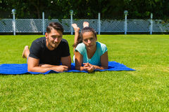 Happy young couple relaxing enjoying the sun. Royalty Free Stock Image