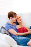Happy young couple relaxing at home Stock Photography