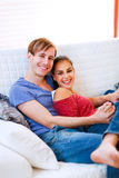 Happy young couple relaxing at home Royalty Free Stock Photos