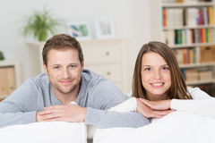 Happy young couple relaxing at home Royalty Free Stock Photo