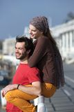 Happy young couple relaxing outdoors Stock Photos