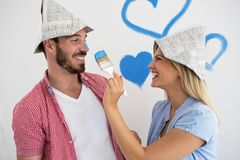 Happy young couple relaxing after painting their home. Happy young couple relaxing after painting home royalty free stock image