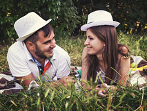 Happy young couple relaxing in the park on the grass Royalty Free Stock Photo
