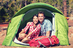 Happy Young Couple Relaxing In Tent Royalty Free Stock Images