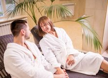 Happy young couple relaxing together at day spa. Side view photo. holiday, weekend stock photos