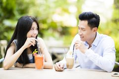 Young couple in restaurant enjoying drink. Happy young couple in restaurant enjoying drink Royalty Free Stock Photos