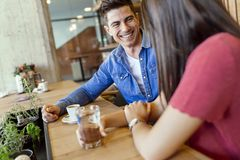 Happy young couple in restaurant royalty free stock photo