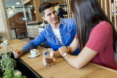 Happy young couple in restaurant Stock Photography