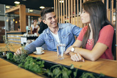 Happy young couple in restaurant Stock Image