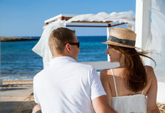 Happy young couple resting near the sea Stock Image