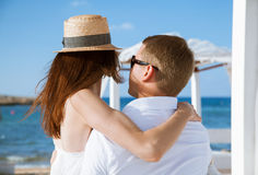 Happy young couple resting near the sea Stock Photo