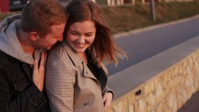 Happy young couple resting on the street, caressing each other and smiling stock video