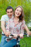 Happy young couple riding bicycle Stock Photography
