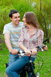 Happy Young Couple Riding Bicycles Royalty Free Stock Images