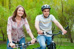 Happy young couple riding bicycles Stock Images