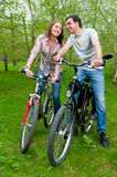 Happy young couple riding bicycles Royalty Free Stock Photo
