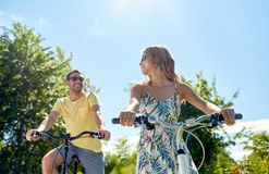 Happy young couple riding bicycles in summer Stock Image